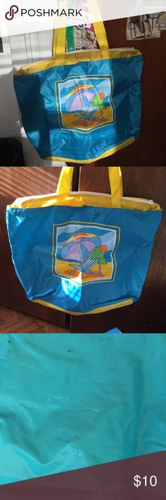 Beach bag. Adorable beach bag w / a print w cute print w a beach chair / umbrella / towel / hat - fun - fun - so roomy good enough to fit everything in there - tons of room -used - see pics - some spots on bag due to wear.🌞☀️👙👙👣👣👒👒👡👡🕶🕶🏊🏄🚣🚣🎣🏖🏝🏖🏖🏖🏝🏝🏝🏝🏖🏖🏖🏖🏜🏜🏜🎏 Bags Totes