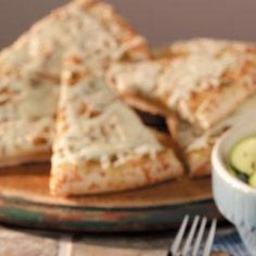 """Cheesy Pesto Bread Recipe -Cheesy Pesto Bread is from Karen Grant of Tulare, California. """"I was out of French bread one day and remembered I had a packaged, prebaked bread crust on hand,"""" she recalls. """"I topped it with pesto and cheese for dinner. Now it's expected whenever I make pasta and salad. It's great heated up for lunch the next day, too."""""""
