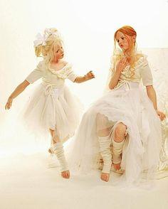 Two girl dolls dressed in white, by artist Hildegard Gunzel, pinned from a Russian website in 2015 #Gunzel #doll