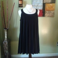 Black Little Swing Dress Black pleated sleeveless dress with rounded neckline.  This number flows with pleats all around the dress and a full 100% spandex Lining.  Designer  signature by Bonnie Bee Signature by Bonnie Bee Dresses
