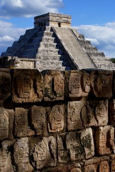 Tzompantli in Chichen Itza with the Pyramid of Quetzalcoatl in the background, Yucatan, Mexico