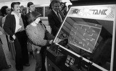 Dec. 7, 1976: Atari and BART entered into a strange partnership, agreeing to split the profits for these video game consoles installed in BART stations. The crowd is from central casting -- you don't get more 1976 than a shag rug sweater.