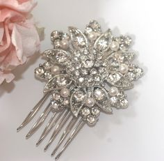 Rhinestone and Swarovski pearl bridal comb, Vintage style diamante and pearl wedding headpiece,. £23.00, via Etsy....LOVE! Want for the wedding...hmmmn maybe