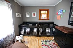 Boy/Girl twin nursery. I like the concept, but would bring in more colors from the rug and use less brown.