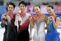 RIFU, JAPAN - NOVEMBER 24: (L-R) Men silver medalist Daisuke Takahashi of Japan, Men gold medalist Yuzuru Hanyu of Japan, Ladies gold medalist Mao Asada of Japan and Ladies silver medalist Akiko Suzuki of Japan pose for photographs at the medal ceremony after their competitions during day two of the ISU Grand Prix of Figure Skating NHK Trophy at Sekisui Heim Super Arena on November 24, 2012 in Rifu, Japan.