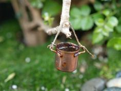 Old rustic fairy cooking pot  in this magical FAIRY GARDEN from The Magic Onions Blog and FairyGardens.com