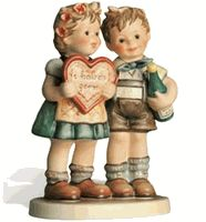 Hummel Gifts of Love  Hummel Figurine 909 This is one of my favorites. It actually brings tears to my eyes to look at these.
