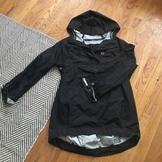 Lululemon rain jacket Love this rain jacket!! Long enough to cover your bum if riding a bike with it - super lightweight and goes great over anything. Has reflective detailing on sleeves for night time and oversized hood. Sad to see this go but just got a new raincoat! In great condition lululemon athletica Jackets & Coats