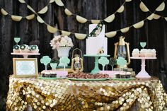I love the gold table skirt and soft colors! This whole party is gorgeous and perfectly themed without being too much.