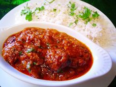 The word vindaloo is derived from the Portuguese words for Vinegar (Vinho) and Garlic (or Al'ho). Vindaloo was carried by Portuguese sailors on their sailing Lamb Vindaloo, The Dish, Portuguese, Cravings, Chili, Spicy, Pork, Food And Drink, Sailing Trips