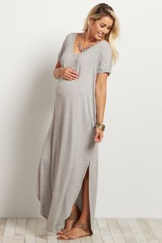 Don't miss out on this perfect summer staple that you can easily dress up or down for every occasion. A solid maternity maxi dress with short sleeves and slit sides to keep you cool in warm weather. Style it with sandals for the beach or dress it up with a statement necklace for an evening out.