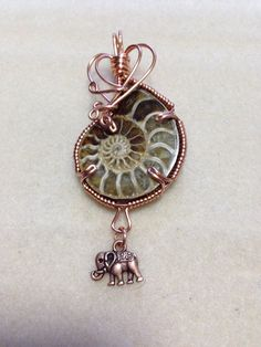 Large ammonite pendant in copper by RavenG on Etsy, $40.00
