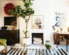 awesome living room, love the tree and the poster