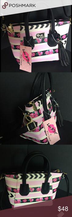 "Betsey crossbody stripe floral pink chevron black Betsey Johnson luvbetsey LBGIYA crossbody satchel mini purse pink/ lilac with floral and white/ black chevron print stripes. Vegan leather. Gold toned hardware. Black tassel keychain. 10"" tall, 5"" deep, 7"" tall. Betsey Johnson Bags Crossbody Bags"