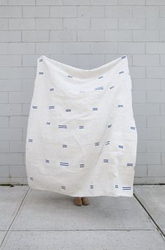 """This linen throw is perfect for a table cloth, beach towel, couch throw, wrap dress, or anything else you can think of. All of our throws are individually block printed by hand with non-toxic acrylic ink. Each throw is pre-washed and ready to be loved. Details: - 100% linen - 1"""" Hem - 72"""" x 56"""" - Proudly made by hand in the U.S.A."""