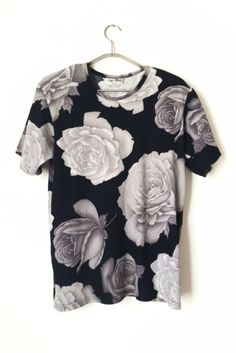 a groundbreaking floral haha Love this top from Handpicked Los Angeles!! It features super unique slits on each side!!