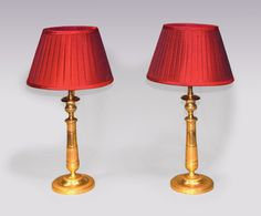 A pair of mid Century ormolu Candlesticks with engine-turned detail throughout, having moulded nozzles and tapering stems, ending on circular bases. (Now converted to lamps.) Height including Shade: 19 ins Circa: 1840 Ref: 5676 Candlestick Lamps, Candlesticks, Lantern Chandelier, Lanterns, Stems, Antique Furniture, Wall Sconces, 19th Century, Engine
