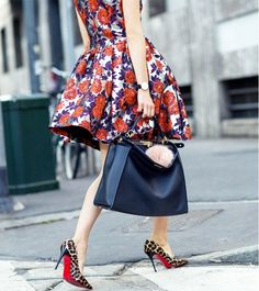 A floral dress is paired with leopard pumps and an Hermes Kelly bag