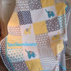 Hey, I found this really awesome Etsy listing at https://www.etsy.com/listing/227326345/elephant-quilt-large-48x54-aqua-yellow