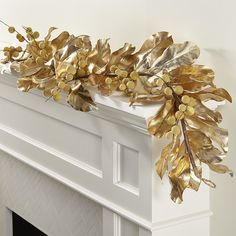 images.crateandbarrel.com is image Crate MagnoliaLonganGarlandGoldSHF17 $web_product_lg$ 170731093321 gold-magnolia-garland.jpg