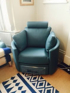 Turquoise leather electric recliner designer chair. & Deep turquoise blue leather on our summer 2014 showroom display ... islam-shia.org