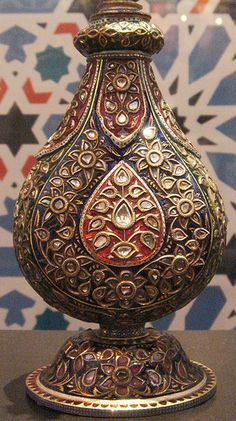 Jewelled Mughal rosewater bottle.The lower part of a rose water bottle on display at an exhibition in Amsterdam but from the permanent collection at the Topkapi Palace Museum in Istanbul, Turkey.
