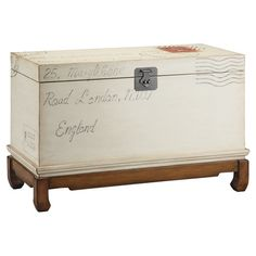 Showcasing a hand-painted stamp motif and decorative latch, this wood storage trunk easily stows soft throws and clothing.      Product: ...