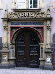 Door, Haus des Handels, Trier, Germany.  I NEED to take pics of the kids here!!!!  Whos with me???