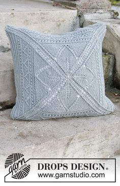 Knitted DROPS pillow case with lace pattern, worked from the middle and outwards in a square in Nepal. Free pattern by DROPS Design.
