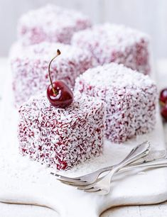 Fresh Cherry and Coconut Lamingtons. Originally from Australia, lamingtons make a delicious teatime treat: mini cakes, decorated in cherry jam and desiccated coconut, topped with a fresh cherry. Mini Desserts, Just Desserts, Baking Recipes, Cake Recipes, Dessert Recipes, Pavlova, Mini Cakes, Cupcake Cakes, Lamingtons Recipe