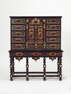Cabinet on stand. Place of origin: Antwerp, Belgium. Date: 1650-1660. Height: 1674 mm cabinet on stand. Veneered with marquetry of tortoiseshell, ebony and ivory, with composition including chips of mother-of-pearl, on an oak carcase, with lacquered brass mounts.  -Victoria and Albert Museum-