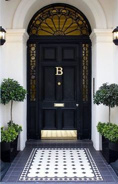 Dream house exterior - how cute is this front entry? Black front door is so classic and dramatic. Add a polished brass hardware package and kick plate, really make it POP with oversized planters, a monogrammed door decal, and area rug tile pattern. Front Door Entrance, Front Entrances, House Entrance, Front Entry, Entry Doors, Doorway, Grand Entrance, Entrance Rug, Entrance Design