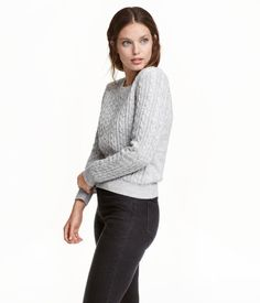 Gray melange. Soft, cable-knit sweater with long sleeves. Flat-knit back section.