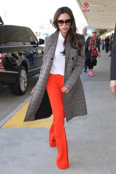 Victoria Beckham wearing Victoria Beckham Double Breasted Checked Coat, Victoria Beckham Pre Fall Flared Trousers