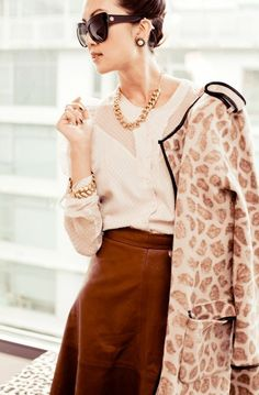 Knit animal print coat compliments off-white silk blouse and brown a-line skirt.