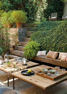 Simple wood garden tables. What a great place for outdoor dining and relaxing. Very pretty and rustic. I like it very much. Wood gives a warm feeling for this relaxing corner.