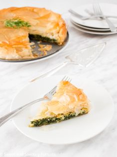 This Easy Spanakopita recipe is based on the classic Greek dish made with phyllo dough, spinach, onions, dill, eggs and feta cheese.