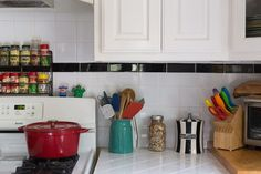 A rainbow of colors pop against this classic black and white kitchen. (Cannot confirm or deny whether or not there were eyelashes in that canister. Interior Architecture, Interior And Exterior, Interior Design, Rainbow Kitchen, Home Salon, New House Plans, House Colors, Color Pop, New Homes