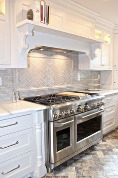 White cabinetry, Gray tile Designed by AKB