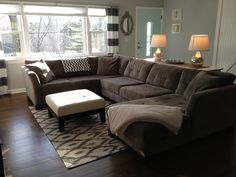 sectional couch with a sofa table behind and lamps for softer lighting. Love the size of the rug too.