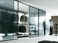 A walk in wardrobe packed with saville row suits.