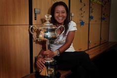 Li Na poses with the Daphne Akhurst Memorial Cup in the women's locker room, F, 25 January 2014.  - Fiona Hamilton/Tennis Australia