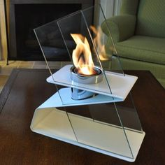 The Kaskade Indoor/Outdoor Fire Pot from Decorpro is a classy fireburner that looks more like a piece of art with its Z-shaped supporting frame and the tempered glass panels that protect the flame without blocking light or heat.