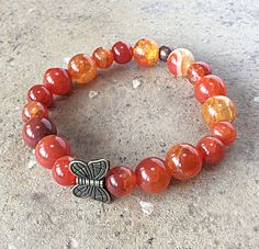 Now available at Butterfly Warriors Jewelry. Orange Butterfly ... Just click here!  http://butterflywarriorsjewelry.com/products/orange-butterfly-bracelet-fire-agate-semiprecious-beads-stacking-stretch-gemstone-jewelry?utm_campaign=social_autopilot&utm_source=pin&utm_medium=pin