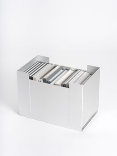 """BOOK BOX FOR AUERBERG  Three anodized """"U-sheets"""" of anodized aluminum, glued together providing a book box: very lightweight, solid, stackable in two directions and with carrying handles on both sides.   H 35 x W 49 x D 30 cm  Boxes is a new collection of Auerberg by: Ana Relvao Christoph Böninger Emanuela Frattini Fritz Frenkler Gerhardt Kellermann Herbert Schultes Studio Irvine Tobias Grau  Auerberg Shop, 245€  http://www.gerhardtkellermann.com/bookbox.php"""