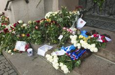 """""""Grief in the public domain"""". Official rose bouquets from the Nordic countries, flowers, candles and greetings on the steps of the Oslo Cathedral 22.08.2011, a month after the terrorist attacks in Oslo and on Utøya."""
