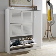 This shoe tidy spells the end of shoes left strewn around the house! Stores up to 24 pairs of shoes.Size:- W97 x H106 x D26cm.Description:- 3 pull-down doors.- 1 louvre door.- Holds up to 24 pairs of shoes.- 1 door and 2 adjustable inside shelves.Features:- In solid pineNitrocellulose varnish finish.Self-assembly.Size and weight of parcel:1 boxWidth.113 x H.26 x D.45cm .Find other models in the Mayor collection online.Home delivery:Your Mayor shoe tidy will be delivered to your door, by…