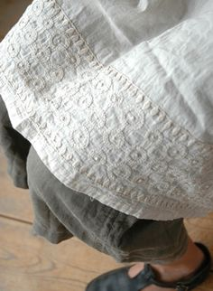 inspiration for simple white cotton tunic with embroidery, here with khaki wide leg crops and dark leather Mary Janes