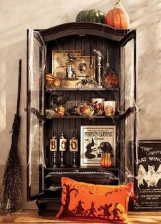 Create a special Halloween corner by transforming a bookcase into a festive spot. HomeDecorators.com