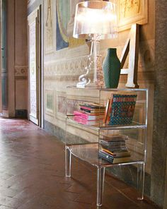 The uses for the Ghost Buster by Philippe Starck are endless. We love it paired with the Bourgie lamp for extra glam factor.